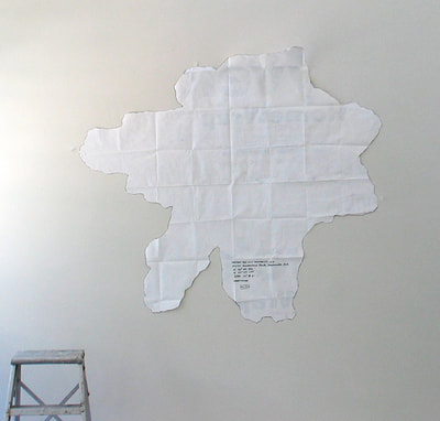 On the white studio wall is the positive of the tree footprint shape, made from the pattern. It is abstract, but vaguely star-shaped.