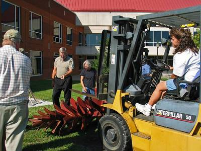 Female forklift driver, two men, and me installing Strobus at the Longwood University campus in Virginia.